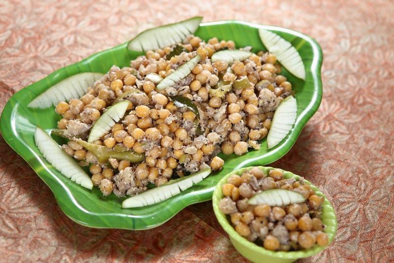 Coconut, raw mango, white peas checkpeas, Thengaai, mangai, pattani sundal. The benefits of raw mangoes are decreased risk of macular degeneration, colon cancer royalty free stock photos