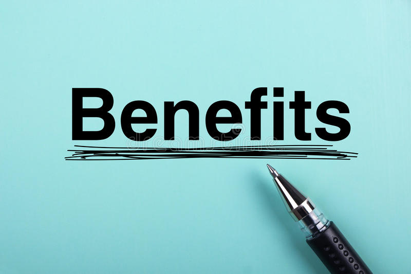 Benefits. Text is on blue paper with black ball-point pen aside royalty free stock image