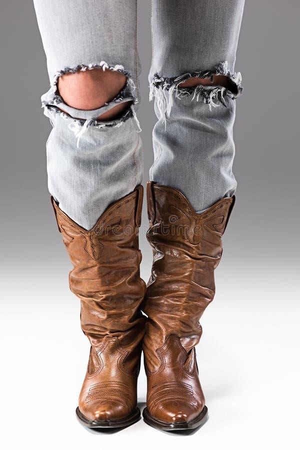 Benen in Jeans en Cowboyslaarzen royalty-vrije stock afbeeldingen