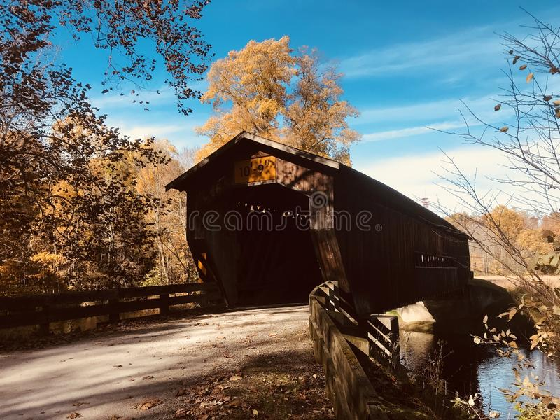 The Benetka Covered Bridge in Ashtabula County - OHIO - USA. Benetka Road Bridge is a covered bridge spanning the Ashtabula River in Ashtabula County, Ohio stock photography
