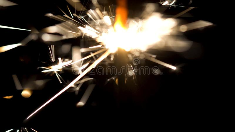 Bengal fire with beautiful sparkles isolated on black background. Media. Burning sparkler in the dark, Merry Christmas stock image