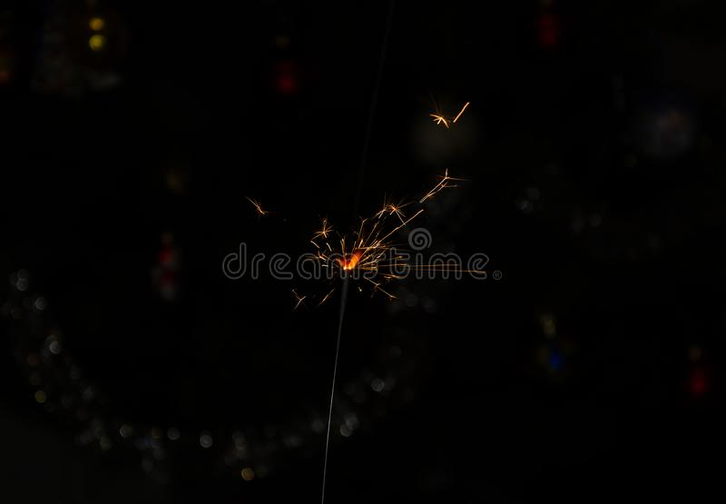 Bengal fire with flying sparks on a dark background royalty free stock image