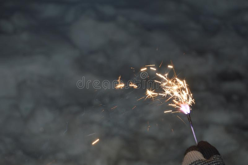 Bengal fire in gloved hand royalty free stock photos