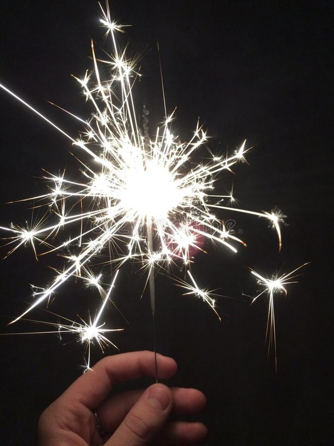 Bengal fire spark. Hundreds of sparks fly from a Bengali stick.every spark is a man`s chance to become happy stock images