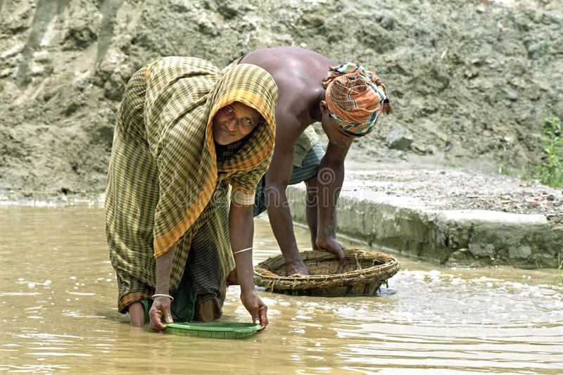 Bengal old women and man working in gravel quarry stock photo
