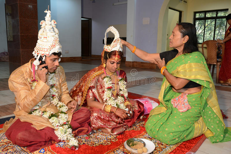 Bengali Marriage. Seniors blessings the couple after marriage stock photography