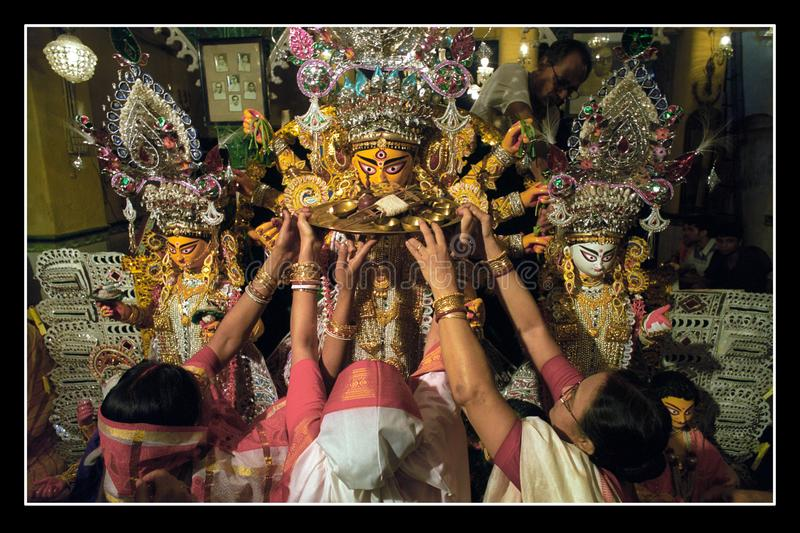 Bidding goodbye to Goddess. Bengali women are bidding their last goodbyes to goddess durga before her immersion in the Ganges river stock photo