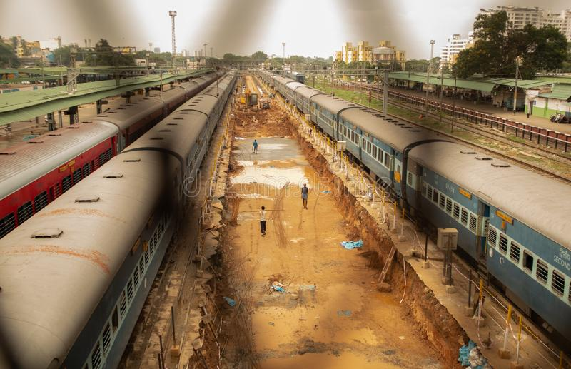 Bengaluru, INDIA - June 03,2019 :Aerial view of busy people in construction work of railway track at bangalore railway station. During morning time royalty free stock image