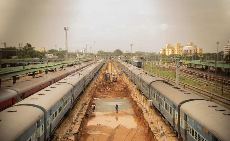 Bengaluru, INDIA - June 03,2019 :Aerial view of busy people in construction work of railway track at bangalore railway station. During morning time royalty free stock images