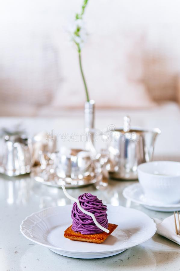 Beni Imo or purple yam Mont Blanc cake, Okinawa famous dessert. On white plate at afternoon tea time royalty free stock images