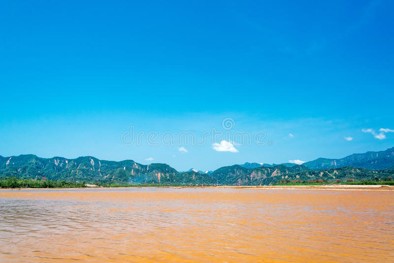 Beni River and Hills. View of the Beni River with lush green hills in the background near Rurrenabaque, Bolivia royalty free stock images