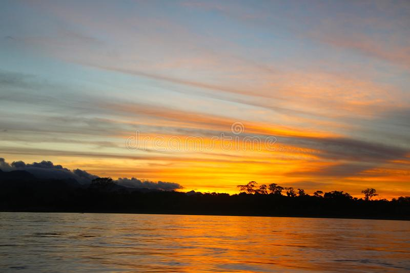 The Beni river on sunset. The Beni river heading into Madidi National Park in the Amazon rainforest near Rurrenabaque, Bolivia stock photo