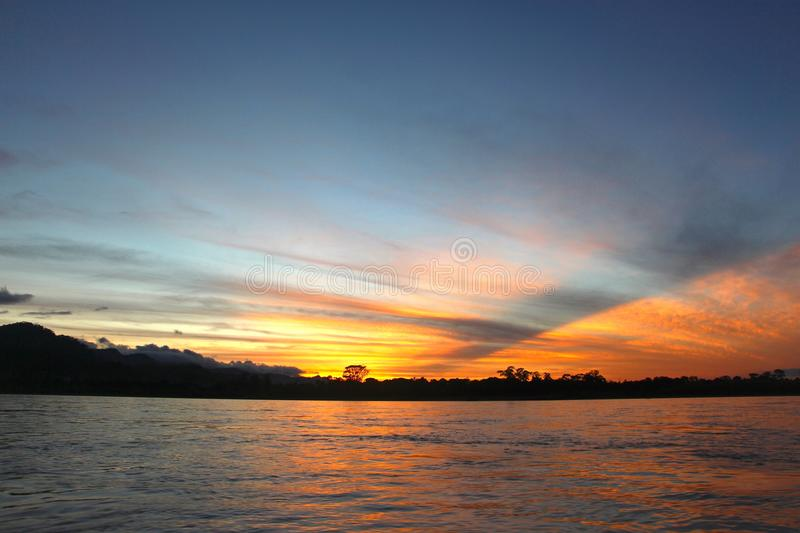 The Beni river on sunset. The Beni river heading into Madidi National Park in the Amazon rainforest near Rurrenabaque, Bolivia royalty free stock photo