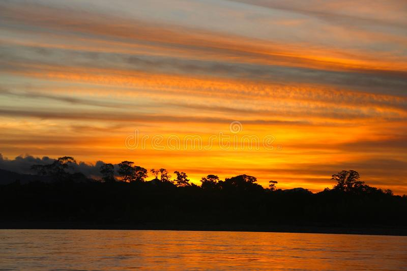The Beni river on sunset. The Beni river heading into Madidi National Park in the Amazon rainforest near Rurrenabaque, Bolivia stock photography