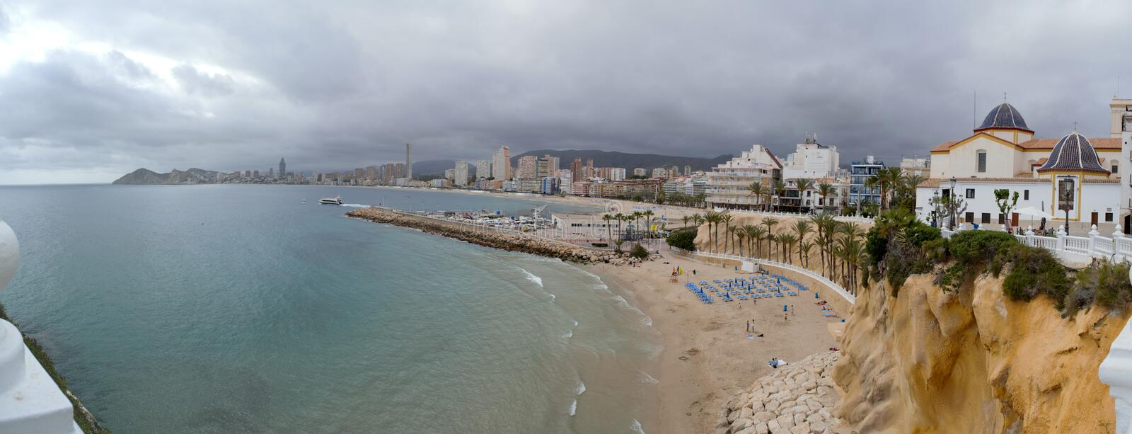 Benidorm,alicante,spain;2019-04-29: Panoramic view of Benidorm beach in Alicante, Spain. Benidorm,alicante,spain;2019-04-29: Panoramic city hall of Benidorm in royalty free stock photography