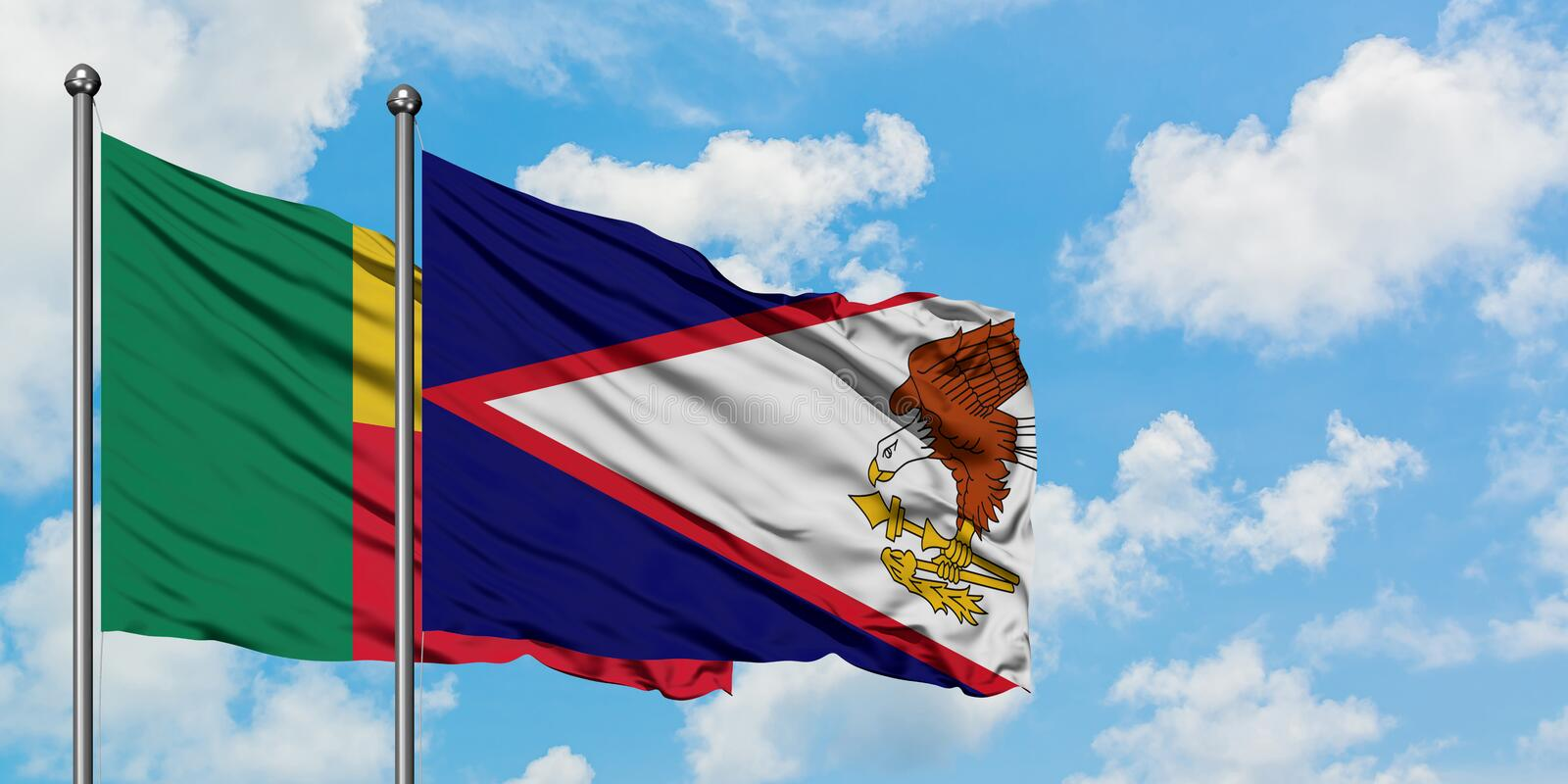Benin and American Samoa flag waving in the wind against white cloudy blue sky together. Diplomacy concept, international. Relations, consul, diplomat stock photos