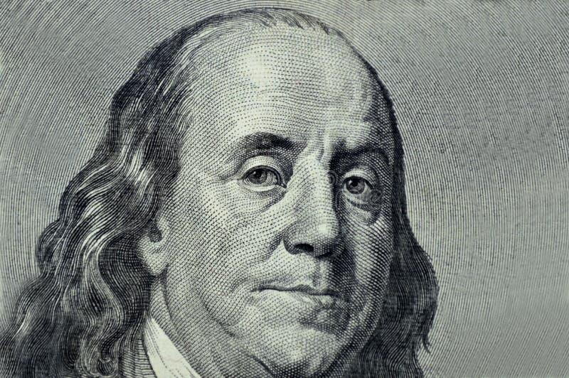 Benjamin Franklin-close-up op een grijze achtergrond royalty-vrije stock foto's