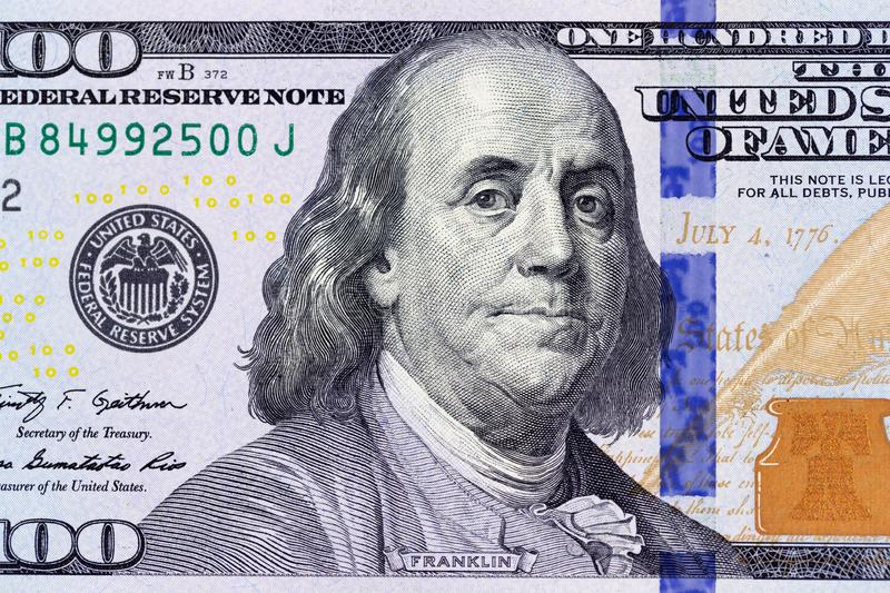 Benjamin Franklin on the 100 dollar bill macro photo. United States of America currency detail.  stock image