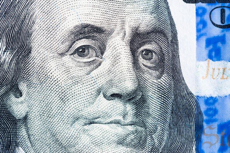 Benjamin Franklin face macro on united states dollar bill royalty free stock photography