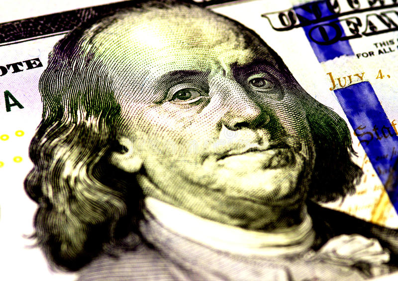 Benjamin Franklin face on US hundred or 100 dollars bill macro, united states money closeup. Benjamin Franklin face on US hundred or 100 dollars bill macro stock image