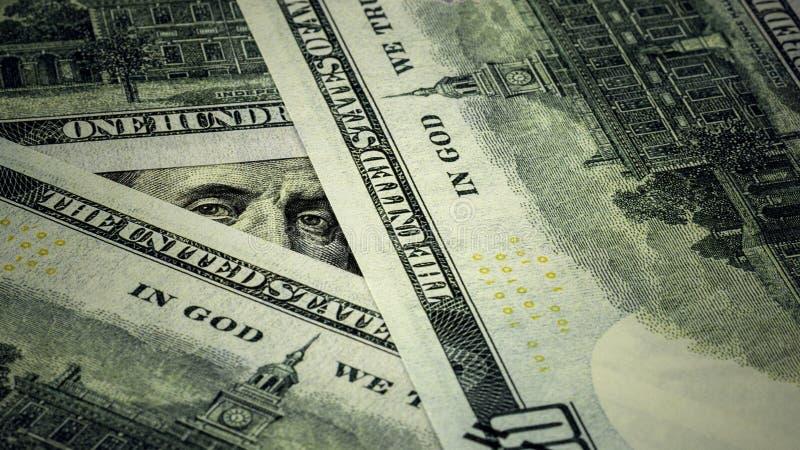 Benjamin Franklin's blik op honderd dollarbiljetten stock afbeelding