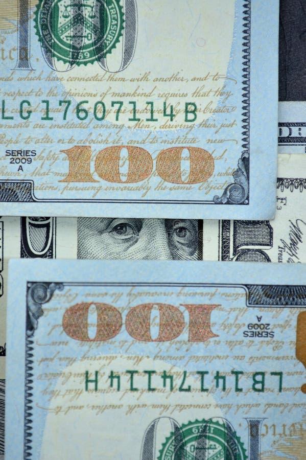 The eyes of Benjamin Franklin on dollars stock photos