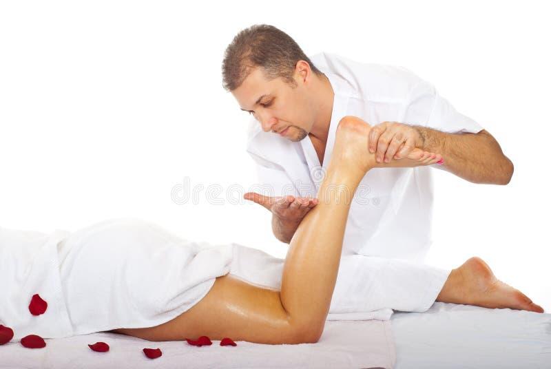 benman som masserar s-terapeutkvinnan arkivbilder