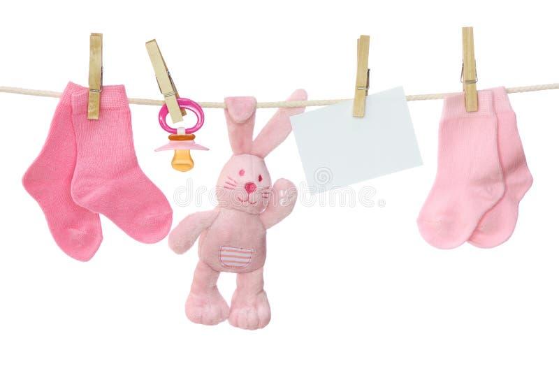 Bens cor-de-rosa do bebê e nota em branco fotos de stock royalty free