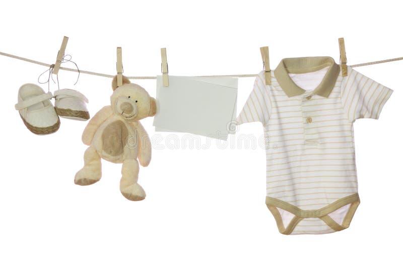 Bens do bebê e nota em branco imagens de stock