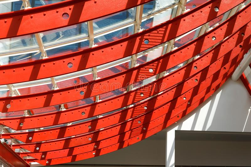 Bent metal structures painted with bright red paint. Illustration of color and design application in modern industry royalty free stock image
