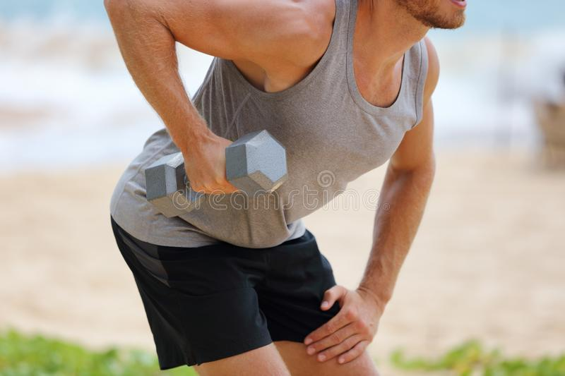 Bent Over Dumbbell Row Exercise - fitness man doing standing row exercise with one free weight. Bent-over Dumbbell Row or Bent. Over row. Person exercising on stock photos