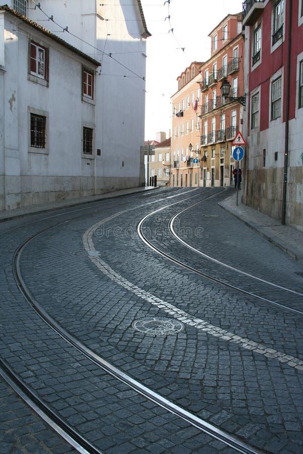 Bent rails. On a cobblestone street in old Lisbon stock photos