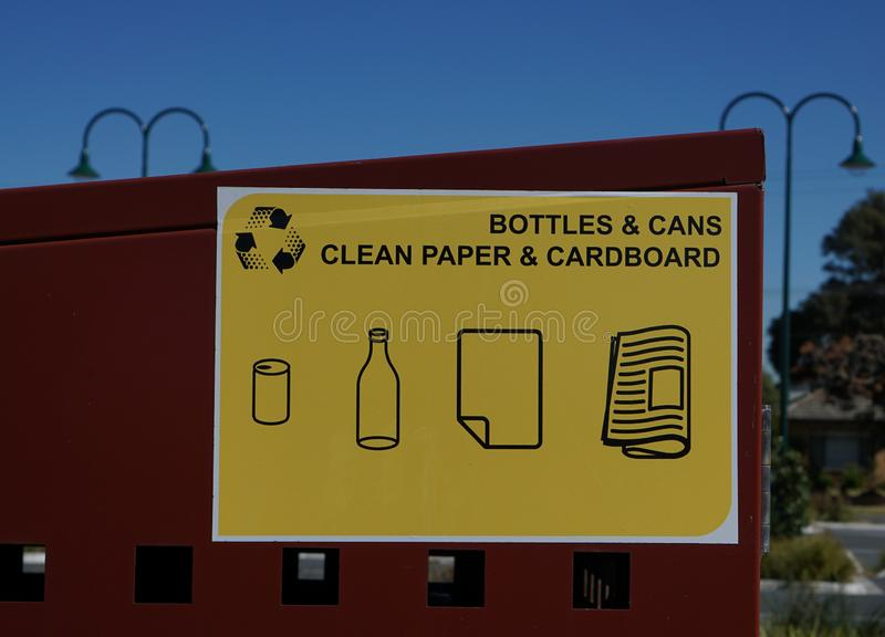 Bottles, cans, clean paper, and cardboard recycling bin sign stock images