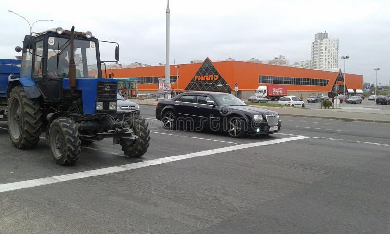 Bentley en tractor royalty-vrije stock foto