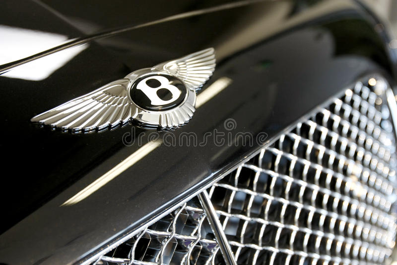 Bentley logo. A Bentley logo is displayed on a Continental GTC car in a new Bentley showroom