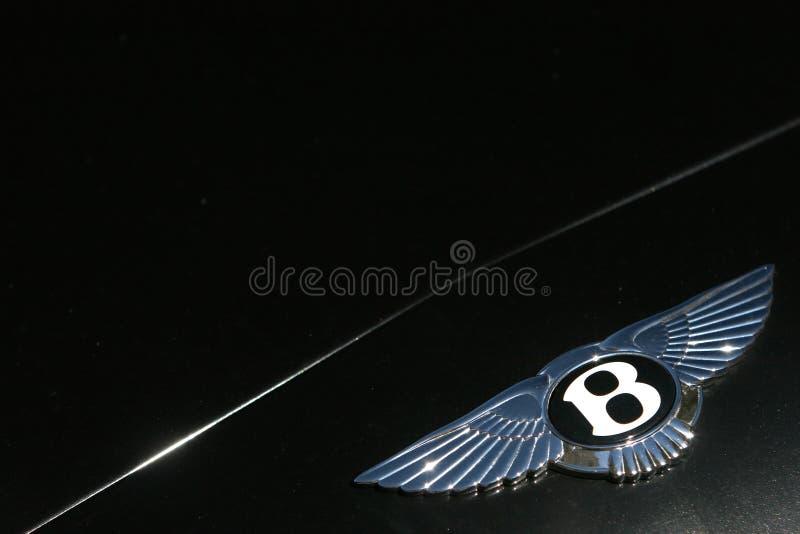 Bentley viaja de automóvel o logotipo na obscuridade - carro desportivo verde imagem de stock royalty free