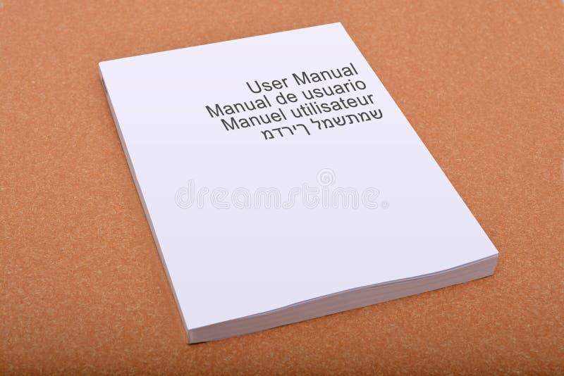 Benutzerhandbuch-Bucheinband mit mehrfachen Sprachen stockbild