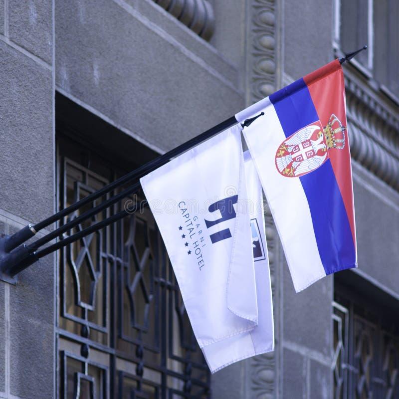 Beograd, Servië, 15 december 2019 - Hotel Capital flags stock afbeeldingen