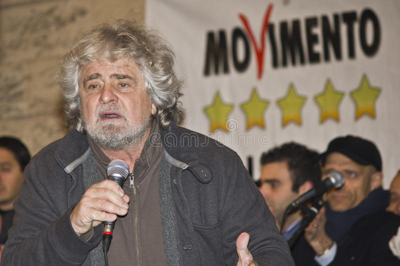 Beppe Grillo,amazed, surprised,angry,screaming,on stage, stock image