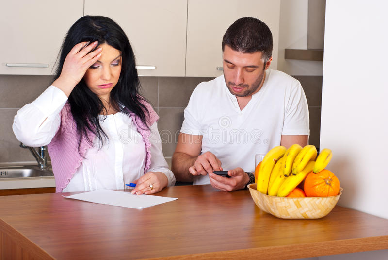 beräkna par som svåra kostnader måste royaltyfria foton