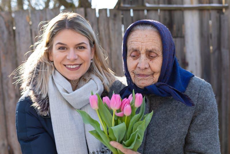 Beröm för dag för kvinna` s royaltyfri fotografi