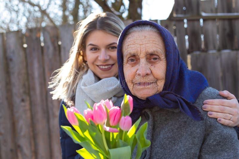 Beröm för dag för kvinna` s fotografering för bildbyråer