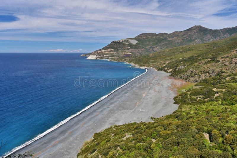 Berömd svart strand av Nonza arkivfoto