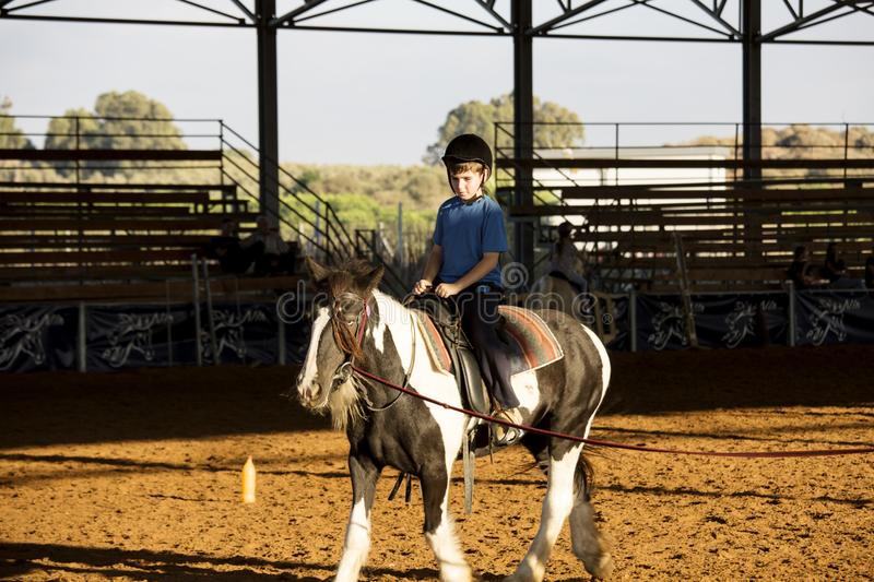 Ber Yakov, Israel - September 28, 2016: Horse riding lessons for kids. The boy on the horse royalty free stock photos