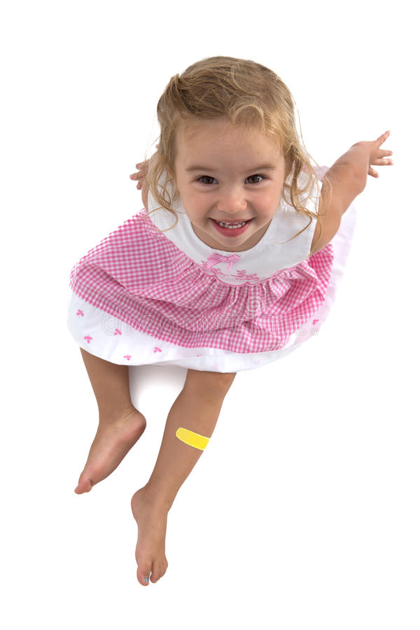 Berbeć dziewczyna ono Uśmiecha się w jej Różowej sukni obraz stock