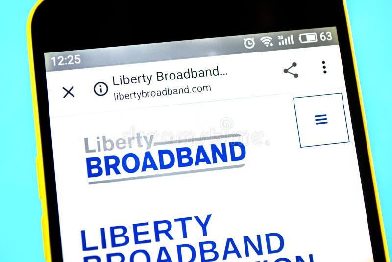 Berdyansk, Ucrania - 12 de mayo de 2019: Editorial ilustrativo del homepage de la p?gina web de Liberty Broadband Logotipo de Lib fotos de archivo