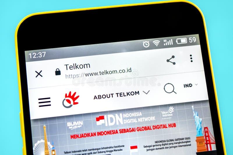 Berdyansk, Ucrania - 12 de mayo de 2019: Editorial ilustrativo del homepage de la p?gina web de Telkom Indonesia Logotipo de Telk imagen de archivo libre de regalías