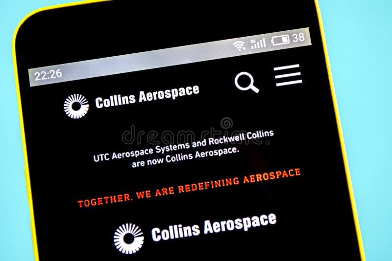 Berdyansk Ukraina - 23 Maj 2019: Homepage för Rockwell Collins rymdwebsite Rockwell Collins logo som är synlig på telefonskärmen royaltyfri foto