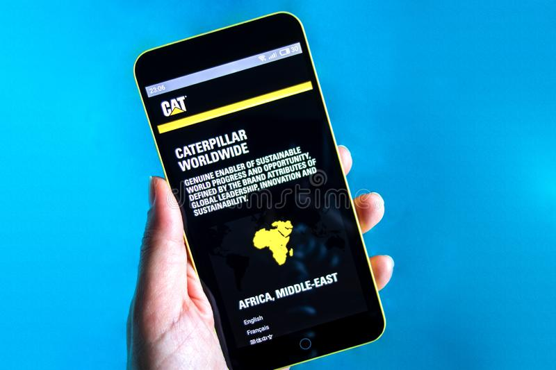 Berdyansk, Ukraine - March 24, 2019: Illustrative Editorial, Caterpillar website homepage. Caterpillar logo visible on the phone. Screen stock photos
