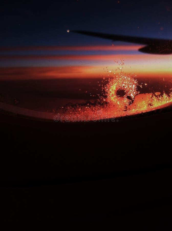 Bereiftes Flugzeugfenster stockbild